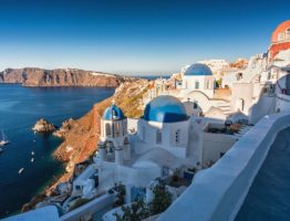 Santorini Island at sunrise, Greece. Traditional white houses wi