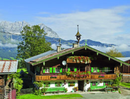 16870620 - mountain farm in tyrol before the panorama of the wilder kaiser